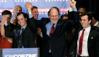 Gubernatorial candidate, Sen. Jon S. Corzine, D-N.J., celebrates with sons Joshua, left, and Jeffrey, right, in East Brunswick, N.J., Tuesday, Nov. 8, 2005. (AP Photo/Mel Evans)