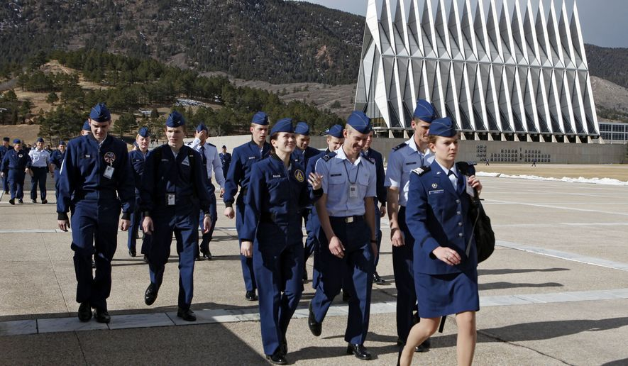 In this Friday, Jan. 20, 2012 photo cadets walk the campus at the Air Force Academy near Colorado Springs, Colo., on their way to the dinning hall for lunch. (AP Photo/Ed Andrieski)