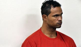 **FILE** In this photo released by the court of Minas Gerais, former Flamengo goalkeeper Bruno Fernandes attends his trial in Contagem, Minas Gerais state, Brazil, on March 7, 2013. Bruno was sentenced to 22 years and 3 months in prison for the death of his ex-girlfriend Eliza Samudio. (Associated Press/Renata Caldeira, Justice Tribunal of Minas Gerais)