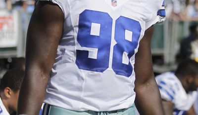 Dallas Cowboys defensive end Clifton Geathers (98) before an NFL preseason football game against the Oakland Raiders in Oakland, Calif., Monday, Aug. 13, 2012. (AP Photo/Ben Margot)