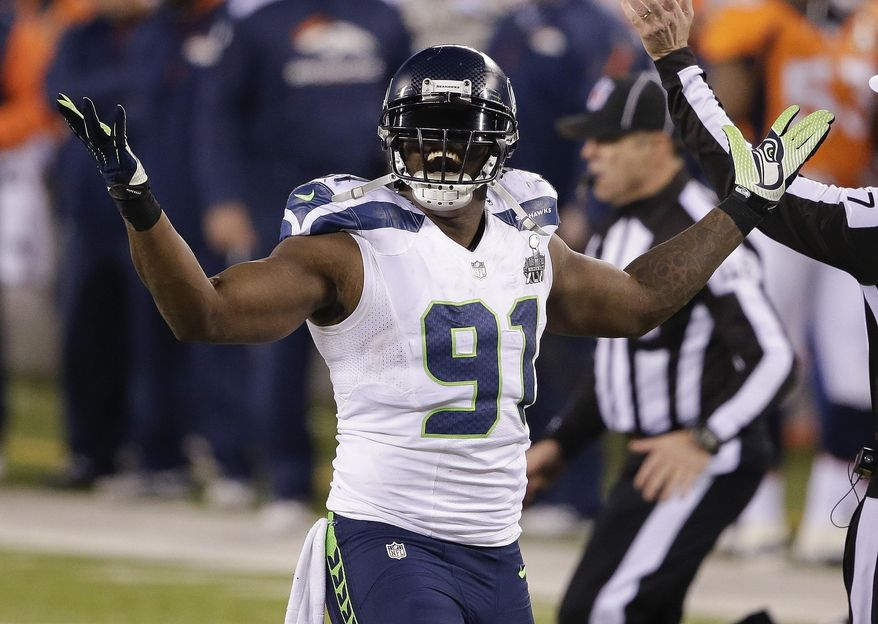 FILE - In this Feb. 2, 2014, file photo, Seattle Seahawks defensive end Chris Clemons reacts to a defensive play against the Denver Broncos during the second half of the NFL Super Bowl XLVIII football game in East Rutherford, N.J. Seahawks released Clemons on Wednesday, March 12, 2014, a move that saves significant salary cap room but takes away one of their top pass rushers the past four seasons. (AP Photo/Gregory Bull, File)