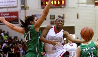 In this Jan. 2, 2014, photo, Princeton's Kelsey Mitchell (1) goes up for a shot against Mason's Makenzie Dixon (21) during a basketball game in Sharonville, Ohio. Mitchell is a unanimous choice as the 2014 Associated Press Ohio Ms. Basketball, winner of the 27th annual award emblematic of the best girls player in the state.(AP Photo/The Cincinnati Enquirer, Joseph Fuqua II) NO SALES