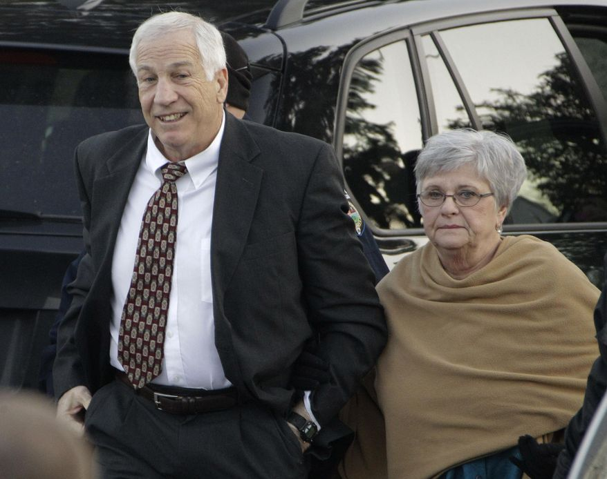 "FILE - In this Dec. 13, 2011 file photo, former Penn State assistant football coach Jerry Sandusky arrives with his wife, Dottie Sandusky, for a preliminary hearing at the Centre County Courthouse in Bellefonte, Pa., where he faced his accusers. In an interview broadcast Wednesday, March 12, 2014 on NBC's ""Today,""  Dottie Sandusky says she ""definitely"" believes her husband is innocent despite his conviction of the sexual abuse of 10 boys.  Jerry Sandusky is serving a 30- to 60-year sentence. (AP Photo/Gene J. Puskar, File)"
