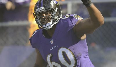 FILE - In this Nov. 10, 2013 file photo, Baltimore Ravens tackle Eugene Monroe waves as he introduced before an NFL football game against the Cincinnati Bengals, in Baltimore. The Ravens and Monroe reached agreement on a five-year contract Friday, March 8, 2014. (AP Photo/Nick Wass, File)
