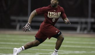 Former Boston College running back Andre Williams runs out for a pass during Boston College Pro Day Wednesday, March 12, 2014, in Boston. Former Boston College football players worked out on the field during the annual draft eligible event in front of NFL scouts and coaches. (AP Photo/Steven Senne)