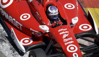 FILE - In this Oct. 6, 2013 file photo, Scott Dixon, of New Zealand, drives through turn three during the second IndyCar Grand Prix of Houston auto race,  in Houston. Sponsors come and go in motor sports, where even the strongest partnerships can quickly unravel because of the economy, a difference of opinion or a change in marketing strategy. But Chip Ganassi has developed a partnership with Target that has lasted 25 years in counting, and the team owner considers the relationship with the retail giant a key element in the growth of his race team and Ganassi himself.  (AP Photo/David J. Phillip, File)