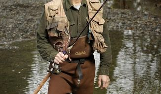 Lyle Cabe, a homegrown Vancouver angler and retired wing commander of Oregon Air National Guard, photographed along the Lewis River at Lewisville Park Monday Jan. 13, 2013 in Battle Ground, Washington. (AP Photo/The Columbian, Troy Wayrynen)