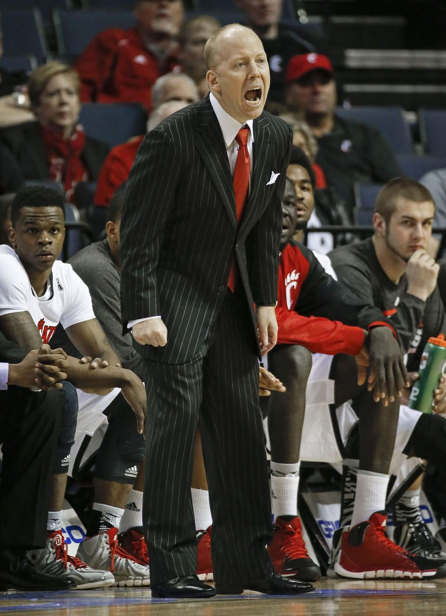 Cincinnati coach Mick Cronin yells to his players during the first half of an NCAA college basketball game against Central Florida in the quarterfinals of the American Athletic Conference men's tournament Thursday, March 13, 2014, in Memphis, Tenn. (AP Photo/Mark Humphrey)