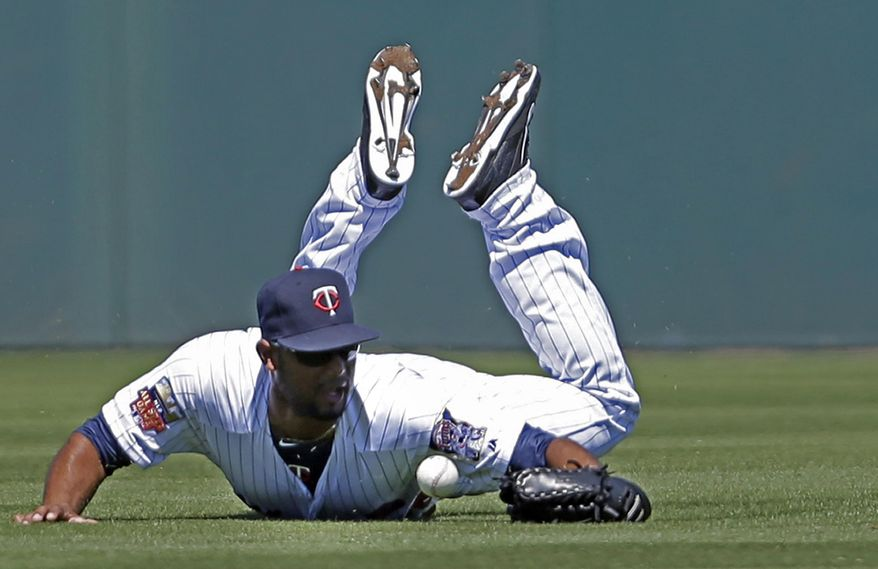 Minnesota Twins center fielder Aaron Hicks (32) dives for a single hit by Boston Red Sox Mike Napoli in the second inning of an exhibition baseball game in Fort Myers, Fla., Thursday, March 13, 2014. (AP Photo/Gerald Herbert)