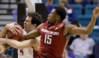 Stanford's Stefan Nastic, left, and Washington State's Junior Longrus vie for a rebound in the first half of an NCAA college basketball game in the Pac-12 men's tournament, Wednesday, March 12, 2014, in Las Vegas. (AP Photo/Julie Jacobson)