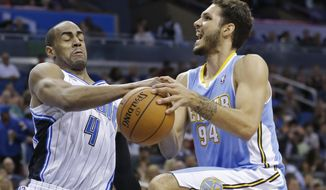 Orlando Magic's Arron Afflalo (4) knocks the ball out of the hands of Denver Nuggets's Evan Fournier (94) as he goes up for a shot during the first half of an NBA basketball game in Orlando, Fla., Wednesday, March 12, 2014. (AP Photo/John Raoux)