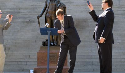Republican U.S. Senate candidate Richard Cash, center, signs an agreement to support any challenger who gets into a runoff with U.S. Sen. Lindsey Graham in June as he stands on the steps of the Statehouse, Thursday, March 13, 2014, in Columbia, S.C. Six GOP candidates have said they want to take on Graham as he seeks a third term. (AP Photo/Jeffrey Collins)