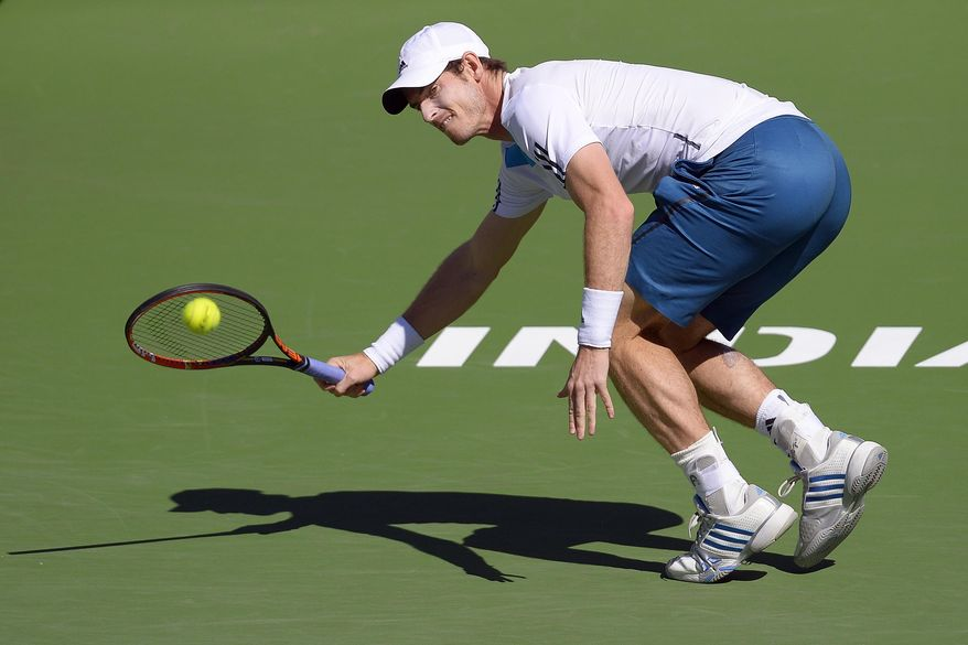 Andy Murray, of Great Britain, returns a shot against Milos Raonic, of Canada, during a fourth round match at the BNP Paribas Open tennis tournament, Wednesday, March 12, 2014, in Indian Wells, Calif. (AP Photo/Mark J. Terrill)