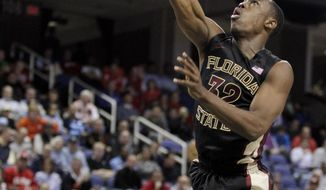 Florida State's Montay Brandon, top, runs into Maryland's Dez Wells, bottom, as he drives to the basket during the second half of a second round NCAA college basketball game at the Atlantic Coast Conference tournament in Greensboro, N.C., Thursday, March 13, 2014. (AP Photo/Bob Leverone)