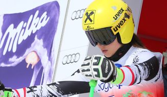 Austria's Anna Fenninger prepares to compete on his way to clock the fastest time during an alpine ski, women's World Cup downhill training, in Lanzerheide, Switzerland, Tuesday, March 11, 2014. (AP Photo/Marco Trovati)