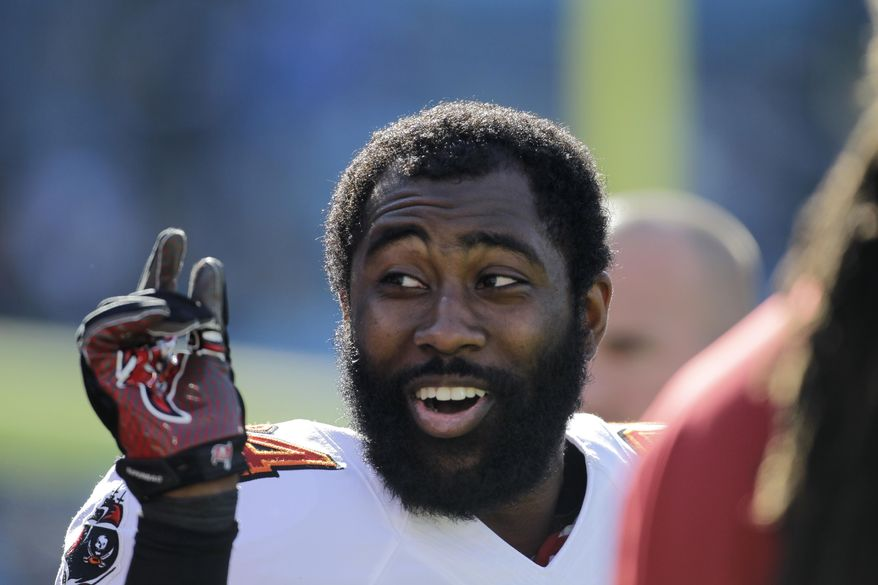 FILE - In this Dec. 1, 2013 file photo, Tampa Bay Buccaneers' Darrelle Revis clowns around with teammates during warm ups before an NFL football game against the Carolina Panthers in Charlotte, N.C. As Day 2 of the NFL's free-agency period began to unfold, Carolina Panthers receiver Steve Smith and Tampa Bay Buccaneers cornerback Darrelle Revis were waiting to find out whether they might be traded or released. (AP Photo/Bob Leverone, File)