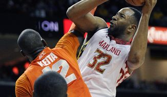 FILE - This Monday, Feb. 24, 2014 file photo shows Maryland's Dez Wells (32) fouled by Syracuse center Baye-Moussa Keita (12) during the second half of an NCAA college basketball game in College Park, Md. A judge has allowed most of the claims in a federal lawsuit filed by Wells, a former Xavier University basketball player against the school and its president to proceed to trial. Wells' lawsuit, filed in August, included 11 claims against the university and its president, Father Michael Graham, including sex discrimination, intentional infliction of emotional distress, libel for injury to his reputation and negligence.  (AP Photo/Nick Wass, File)