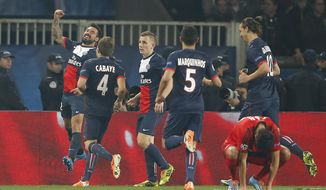 PSG's Ezequiel Lavezzi, left, celebrates his side's second goal with teammates during a Champions League last 16 second leg soccer match between Paris Saint Germain against Bayer Leverkusen at Parc des Princes stadium in Paris, Wednesday, March 12, 2014. (AP Photo/Michel Euler)