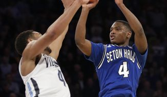 Seton Hall's Sterling Gibbs, right, shoots the game-winning shot over Villanova's Darrun Hilliard in the closing seconds of the second half of an NCAA college basketball game in the second round of the Big East Conference tournament at Madison Square Garden, Thursday, March 13, 2014 in New York. Seton Hall defeated Villanova 64-63.(AP Photo/Seth Wenig)