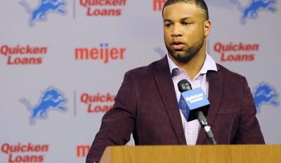 Newly-signed  Detroit Lions wide receiver Golden Tate talks with the media about his contract at The Detroit Lions headquarters in Allen Park, Mich., on Wednesday, March 11, 2014. (AP Photo/Detroit News, Elizabeth Conley)