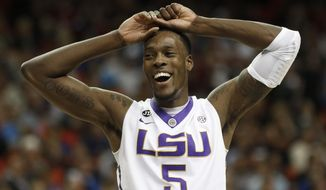 LSU forward Shavon Coleman (5) celebrates a goal against Alabama during the second half of an NCAA college basketball game in the second round of the Southeastern Conference men's tournament, Thursday, March 13, 2014, in Atlanta. LSU won 68-56.(AP Photo/John Bazemore)
