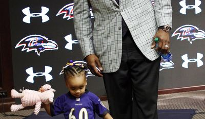 Baltimore Ravens tackle Eugene Monroe, right, steps off a stage with his daughter Farah, 2, after discussing his new five-year contract at an NFL football news conference Wednesday, March 12, 2014, at the team's practice facility in Owings Mills, Md. (AP Photo/Patrick Semansky)