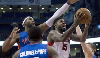 Toronto Raptors forward Amir Johnson (15) is fouled as he drives throught Detroit Pistons forward Jonas Jerebko (33), center Andre Drummond. left.  and guard Kentavious Caldwell-Pope (5) during first half NBA basketball action in Toronto on Wednesday March 12, 2014. (AP Photo/The Canadian Press, Frank Gunn)