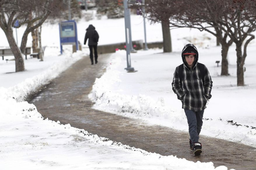 Mike Bliss takes a snowy walk to his class at Harper College after a winter storm Wednesday, March 12, 2014, in Palatine, Ill. ,(AP Photo/Daily Herald, Bob Chwedyk) MANDATORY CREDIT, MAGS OUT, TV OUT