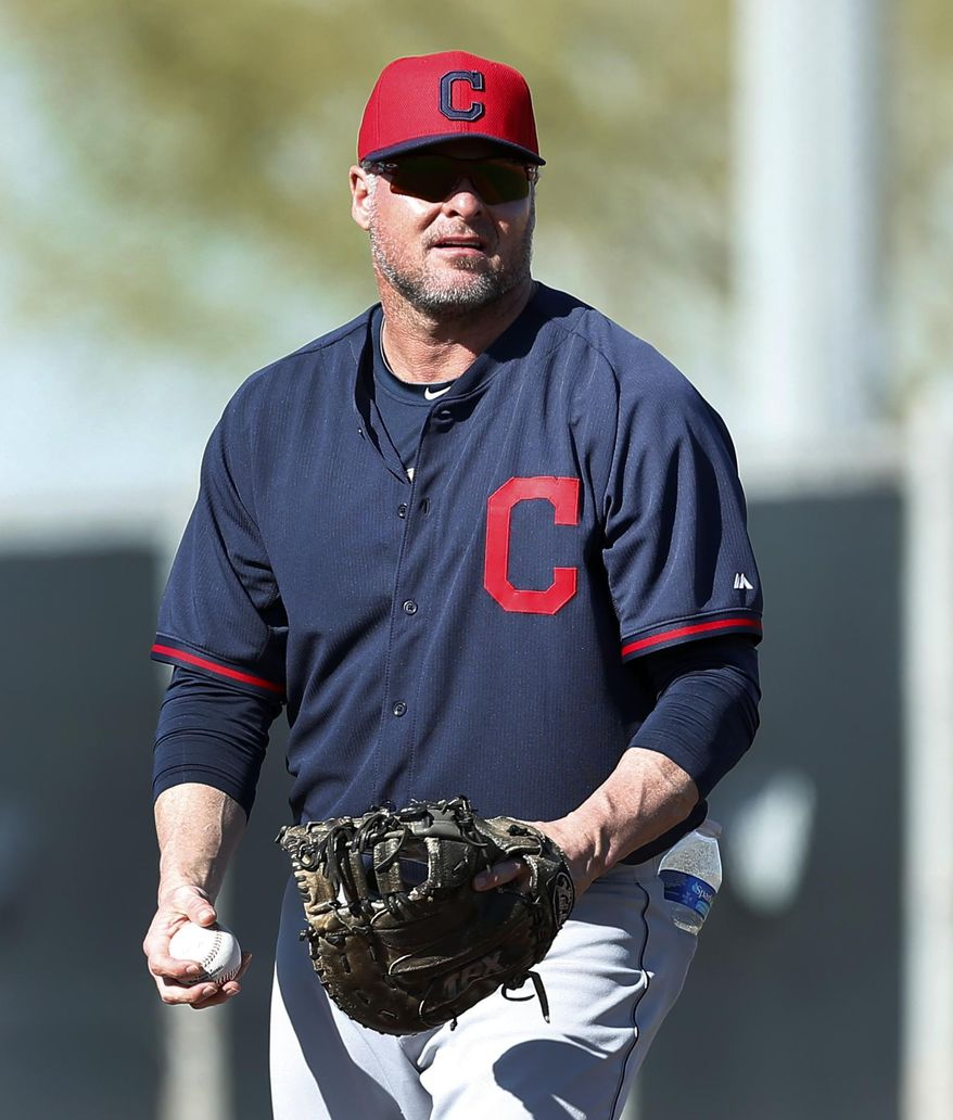 FILE - In this Feb. 17, 2014, file photo, Cleveland Indians' Jason Giambi plays first base during a spring training baseball practice in Goodyear, Ariz. Giambi will be sidelined for about three-to-four weeks with a broken rib in his right side after being hit by a pitch thrown from Edwin Jackson of the Chicago Cubs in the third inning of a March 7 game. (AP Photo/Paul Sancya, File)