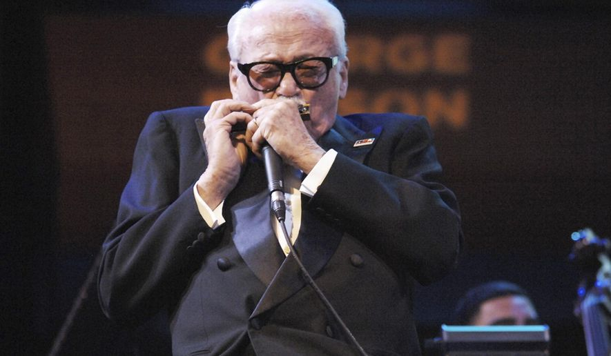 FILE - In an Oct. 17, 2008 file photo provided by the National Endowment for the Arts, Belgium's Toots Thielemans performs at the Rose Theater in New York. Belgium's jazz musician Toots Thielemans has decided to retire together with his trademark harmonica at age 91. Thielemans made the announcement on Wednesday, March 12, 2014, on the eve of a concert in Antwerp, Belgium which has now been cancelled. (AP Photo/National Endowment for the Arts, Tom Pich, File)