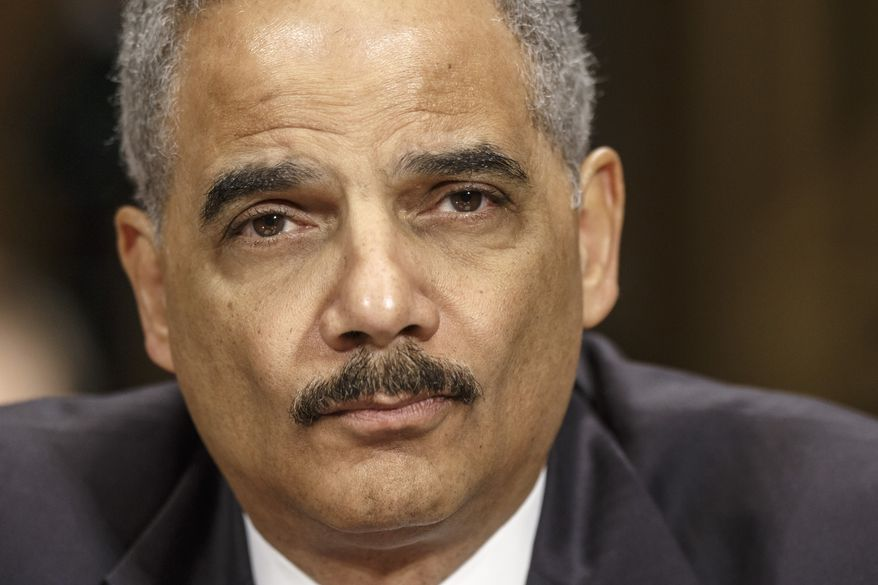 ** FILE ** This Jan. 29, 2014, file photo shows Attorney General Eric Holder on Capitol Hill in Washington. (AP Photo/J. Scott Applewhite, File)