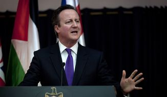 British Prime Minister David Cameron talks during a joint press conference following his meeting with Palestinian President Mahmoud Abbas at his headquarters in the West Bank city of Bethlehem, Thursday, March 13, 2014. (AP Photo/Nasser Nasser)
