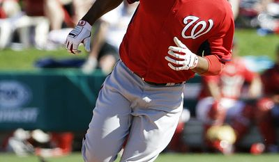 Washington Nationals' Destin Hood rounds second base after hitting a home run to score teammates Mike Fontenot and Jason Martinson in the eighth inning of an exhibition spring training baseball game against the St. Louis Cardinals, Saturday, March 8, 2014, in Jupiter, Fla. (AP Photo/David Goldman)