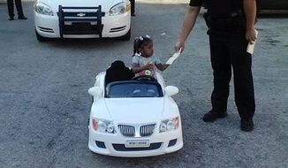 Za'Dariyah Mishaw, 2, of Jacksonville, was cruising through the parking lot of her condominium complex when two police officers in her neighborhood pulled over her toy convertible. (First Coast News via Facebook)