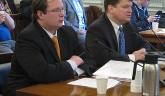 Natural Resources Commissioner Joe Balash, right, addresses the Senate Finance Committee on Friday, March 14, 2014, in Juneau, Alaska. Pictured beside him is Deputy Revenue Commissioner Mike Pawlowski. (AP Photo/Becky Bohrer)