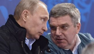 In this photo taken Saturday, March 8, 2014, Russian President Vladimir Putin, left, and International Olympic Committee President Thomas Bach speak during the ice sledge hockey match between Russia and South Korea of the 2014 Winter Paralympics in Sochi, Russia. (AP Photo/RIA-Novosti, Alexei Nikolsky, Presidential Press Service)