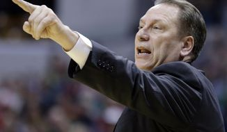 Michigan State head coach Tom Izzo directs his team in the second half of an NCAA college basketball game against Northwestern in the quarterfinals of the Big Ten Conference tournament Friday, March 14, 2014, in Indianapolis. (AP Photo/Michael Conroy)