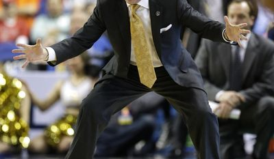 Georgia Tech head coach Brian Gregory directs his team against Clemson during the second half of a second round NCAA college basketball game at the Atlantic Coast Conference tournament in Greensboro, N.C., Thursday, March 13, 2014. (AP Photo/Gerry Broome)