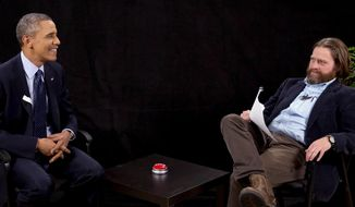 "This image from video released by Funny Or Die shows President Obama, left, with actor-comedian Zach Galifianakis during an appearance on ""Between Two Ferns,"" the digital short with a laser focus on reaching people aged 18 to 34. Obama's appearance posted Tuesday, March 11, 2014, on the comic website Funny or Die, is at 15 million views by Friday. (AP Photo/Funny Or Die)"