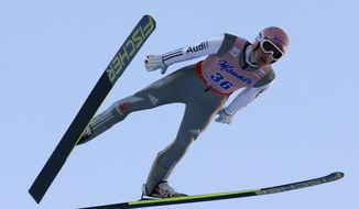 Severin Freund from Germany competes during the Ski Flying World Championships in Harrachov, Czech Republic, Friday, March 14, 2014. (AP Photo/Petr David Josek)