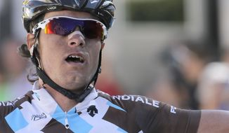 Carlos Alberto Betancur Gomez, of Colombia, celebrates after winning the sixth leg and taking the overall leaders jersey of the Paris-Nice cycling race, between Saint Saturnin les Avignon and Fayence, southeastern France, Friday, March 14, 2014. (AP Photo/Lionel Cironneau)