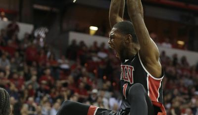 UNLV's Roscoe Smith dunks during the first half of an NCAA college basketball game against San Diego State in the semifinals of the Mountain West Conference tournament Friday, March 14, 2014, in Las Vegas. (AP Photo/Isaac Brekken)