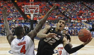 Missouri guard Jabari Brown (32) shoots over Florida center Patric Young (4) during the second half of an NCAA college basketball game in the quarterfinal round of the Southeastern Conference men's tournament, Friday, March 14, 2014, in Atlanta. (AP Photo/Steve Helber)
