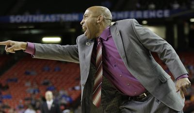 Mississippi State head coach Rick Ray speaks to players against the Mississippi during the first half of an NCAA college basketball game in the second round of the Southeastern Conference men's tournament, Thursday, March 13, 2014, in Atlanta. (AP Photo/Steve Helber)
