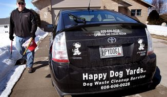 """ADVANCED FOR RELEASE MONDAY, MARCH 17, 2014 Happy Dog Yards owner Brad Erickson returns to his vehicle after completing a job Wednesday, March 13, 2014. Erickson charges """"by the dog"""" for his pop cleanup service. (AP Photo/La Crosse Tribune, Peter Thomson)"""