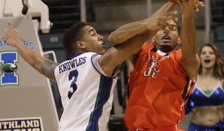 Sam Houston State's  Michael Holyfield (35) is fouled by Texas A&M-CC's  Zane Knowles (3)during the first half of an NCAA college basketball game in the semifinal round of the Southland Conference tournament Friday, March 14, 2014, in Katy. (AP Photo/Bob Levey)