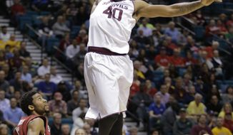 Arizona State's Shaquielle McKissic goes in for a dunk against Stanford in the first half of an NCAA college basketball game in the Pac-12 men's tournament quarterfinals, Thursday, March 13, 2014, in Las Vegas. (AP Photo/Julie Jacobson)