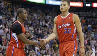 Los Angeles Clippers' Chris Paul, left, congratulates teammate Blake Griffin (32) in the second half during an NBA basketball game against the Utah Jazz, Friday, March 14, 2014, in Salt Lake City. The Clippers won 96-87. (AP Photo/Rick Bowmer)
