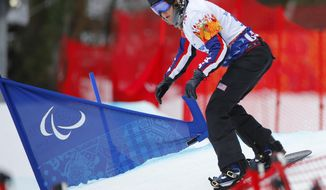 Amy Purdy of United States competes during women's para snowboard cross, standing event at the 2014 Winter Paralympic, Friday, March 14, 2014, in Krasnaya Polyana, Russia. (AP Photo/Dmitry Lovetsky)
