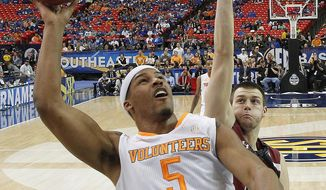 Tennessee forward Jarnell Stokes (5) shoots over South Carolina forward Laimonas Chatkevicius (14) during the first half of an NCAA college basketball game in the quarterfinal round of the Southeastern Conference men's tournament, Friday, March 14, 2014, in Atlanta. (AP Photo/John Bazemore)
